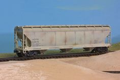 """Started life as an Accurail """"Florida Tile"""" covered hopper. After removing the logo, I applied some light weathering and now I have a plain jane car for my grain fleet."""