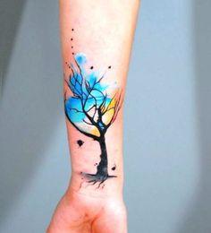 arvore no braço tattoo feminina