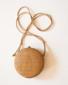 Unique VIntage Round Woven Straw Frame Bag with Rope Strap. $25.00, via Etsy.