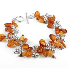 """Amber Dangle Bracelet Item No. AM00285A01 $150.49 This fantastically fun and very pretty amber and sterling silver bracelet consists of a many natural, polished amber beads from the Baltic Sea, and hallow silver balls. The beads are arranged in such a way that they dangle beautifully. This fun 8"" bracelet has genuine Baltic honey and butterscotch hued amber. Ring and bar toggle clasp. A great bracelet for wrist sizes 7 - 7 3/4 (Approximately)."" Amber Beads, Amber Jewelry, Amber Ring, Baltic Amber, Baltic Sea, Amber Bracelet, Sterling Silver Bracelets, Dangles, Gems"