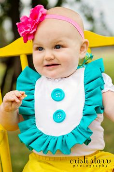 Baby BIB Cake Smash TEAL / Turquoise Aqua Ruffle Dress Bib for Baby - Retro, Colorful, Mod Buttons and Ribbon, First Birthday. $19.99, via Etsy.