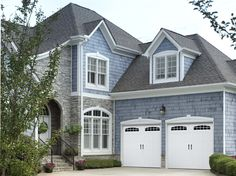 Amarr Bead Board Panel garage door in True White with Cascade DecraTrim and optional Blue Ridge Handles. Visit www.amarr.com for more great styles.