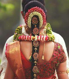Red and gold silk kanchipuram sari.Side braid with fresh jasmine flowers. Bridal Hairstyle Indian Wedding, South Indian Bride Hairstyle, Bridal Hairdo, Indian Wedding Hairstyles, Bride Hairstyles, Hairstyles For Gowns, Kerala Bride, Hindu Bride, Tamil Wedding