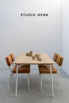 The Flyta Table and Ode Dining Chairs are unique Dutch Design pieces created by Studio HENK. All of the furniture is customisable so that you can create your own one-of-a-kind dining room setting that perfectly matches your interior. #studiohenk #flyta #diningtable #quadpod #diningchairs #chairdesign #orangeinterior #coralinterior #interiorinspiration #oakfurniture #slowliving #dutchdesign #lifestyle #minimalism Studio, Modern, Trendy Tree, Studios