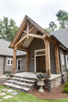 Timber Frame Entry With Stone And Vinyl Siding I Would