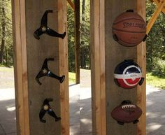 Ball holders for the man cave or boy's room.Line them up along the ceiling in a sports room.  Huh!