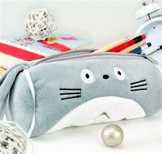 Now you can carry around Totoro as a unique pencil case! This cute pencil case is soft and cuddly, and can be carried from class to class with its nifty, plush handle. The Totoro Pencil Case can carry up to 35 pens and pencils, as well as other everyday accessories and essentials.