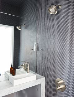 The wet bathroom, clad in Savoy penny tile by Ann Sacks, helped optimize the home's petite footprint.