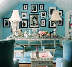 Interior designer Mary McDonald's home office exudes the vintage, feminine glamour she is known for. The ice blue color palette and chinoiserie style tree mural allow the black and white fashion photography to take center stage.  Source