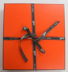 Iconic orange box tied the old way before we started saving ribbon by wrapping on the diagonal.