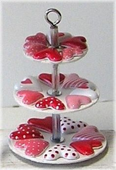 how to: Valentine's Day tiered server red hearts on top of cookie hearts on foam heart tray with middle metal pole