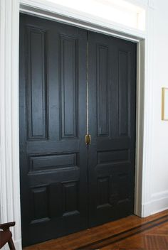 Pocket doors in Onyx by Benjamin Moore, pearl finish; via Manhattan Nest. Should I do all interior doors? Manhattan Nest, Black Doors, Pocket Doors, My Living Room, Windows And Doors, Interior And Exterior, Interior Doors, Interior Paint, Interior Decorating