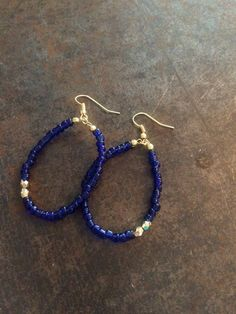 Hand beaded blue seed bead earrings with two gold accent beads on gold filled hooks by ReigningFreedom1 on Etsy