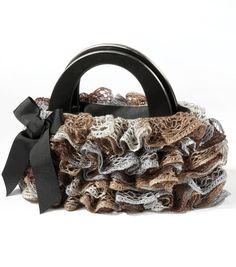 Check out this adorable ruffle purse made with Sashay yarn!