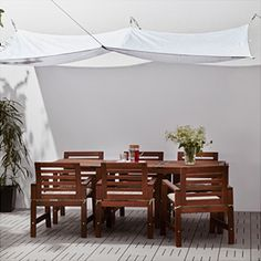 Ikea dyning canopy in white, as seen in a modern tropical outdoor space