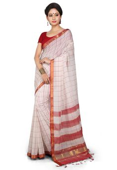 This drape is designed with zari woven The pallu end is further enhanced with fringes Available with an off white and red cotton blouse in unstitched form Free Services: Fall and edging (Pico) Do note: Blouse shown in the image is just for presentation purpose only. (Slight variation in actual color vs. image is possible)