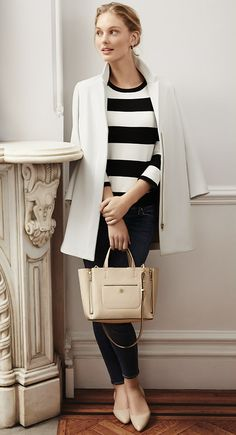 Pair a graphic stripe sweater with neutral accessories for a classic look | @andwhatelse