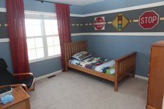 For a boy that loves cars, Created a road around the room as a border by using a two pieces of wood trim as the white lines of the road and taped out the middle to paint the yellow middle line.  Added road signs and framed art from the BWM museum., Boy's room with a wood trimmed road as a border, Boys' Rooms Design