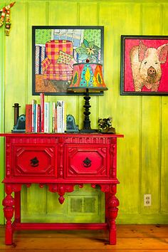Kristin and Mark Nicholas House in Franklin County, Massachusetts - Pictures made by Kristin (a published illustrator and author) and a 1920s sideboard (once belonging to Kristin's great-aunt) got new life with a bright coat of red. - Photo Rikki Snyder