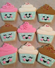 Happy face cupcakes decorated sugar cookies by Tina Grant.  Galletas decoradas