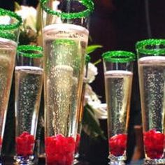 Reindeer Bubbles {Holiday Party Recipe} This glass of bubbly is all dressed up for Christmas with the help of some Pomegranate and green rimming sugar. Switch out the green for silver and you have a fun drink for New Year's eve as weel. Switch out the champagne for sparkling cider for a family friendly version to celebrate with.