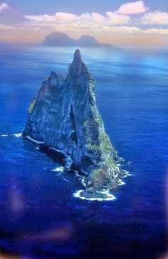 Ball's Pyramid ,Australia - remnant of a shield volcano and caldera that formed about 7 million years ago. It lies 20 kilometers southeast of Lord Howe Island in the Pacific Ocean. It is 562 meters high, while measuring only 1,100 meters in length and 300 meters across, making it the tallest volcanic stack in the world.Ball's Pyramid is part of the Lord Howe Island Marine Park in Australia.