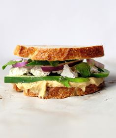 Think vegetarian sandwiches are flavorless? Think again. Here, salty feta, crunchy cucumber, and cool mint liven up thick multigrain slices smeared with smooth hummus. Bright, creamy, and peppery, it's a combo that proves healthy doesn't have to mean ho-hum.