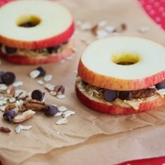 20 Quick & Healthy Snack Ideas- This one looks like my favorite! Sliced and cored apples filled with peanut butter, oats, nuts, and chocolate chips