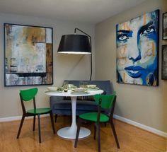 little Saarinen table + green chairs + great paintings