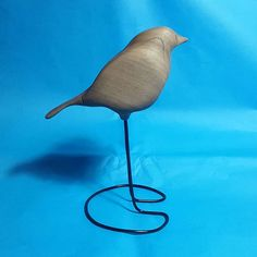 Handcarved walnut robin now has legs 👍   Available to order on my website: www.paperandwood.co.uk  Also at Etsy.com, shop name: ZackMclaughlin  .  .  .  .  #wood #carving #woodworking #handmade #homemade #bird #robin #detail #design #interiordesign #blue #3d #bird #craft #art #artsandcrafts #woodcarving #sculpture #beauitfulwood #simple #silhouette #form #gift #home #interior