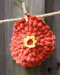 Add some floral fun to your kitchen decor with this zinnia dishcloth.