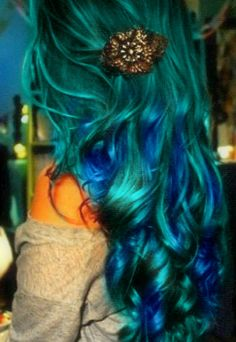 peacock hair. It's just cool, I wonder if I could pull off this color underneath with brown covering it so it peeks through
