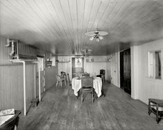 "New Baltimore, Michigan, circa 1901. ""The Firs -- dining room."" This house's amenities included radiant heat, Edison lamps and much wood."
