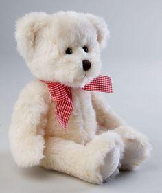 Plush toy bear with bow cream