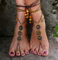 This listing is for a pair of barefoot sandals.    Beautiful and unique barefoot sandals with a tribal vibration. They look great as necklace or on