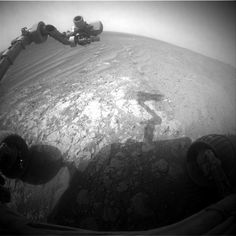 Opportunity Pausing at a Bright Outcrop on Endeavour Rim, Sol 3854 NASA's Mars Exploration Rover Opportunity is continuing its traverse southward on the western rim of Endeavour Crater during the fall of 2014, stopping to investigate targets of scientific interest along way. This view is from Opportunity's front hazard avoidance camera on Nov. 26, 2014, during the 3,854th Martian day, or sol, of the rover's work on Mars. This camera is mounted low on the rover and has a wide-angle lens.