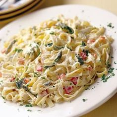 Creamy Fettuccine with Rainbow Veggies  -  They say you should eat the rainbow. This pasta makes it easy! From Spoonful, found at www.edamam.com.