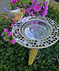 Bird feed made from glass mosaic dish and upside down glass vase