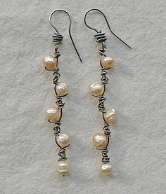 Nina Bagley -- willow earrings  ...interesting technique of using a single wire to be foundational and also overlay the decorative