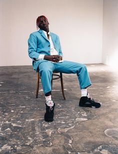 lil yachty, prince of fun | Lil Yachty wears suit jacket and trousers Charles Jeffery LOVERBOY. Shirt Martine Rose. Jewelry, socks, and sneakers model's own. Photography Maxwell Cole
