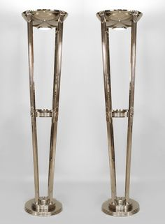 Pair of French Art Deco style chrome floor lamps with 4 fluted supports holding a large bowl with a frosted glass bottom