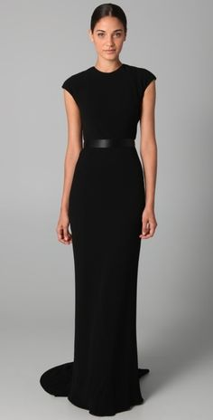 for a black-tie event where no one steps on trains: an elegant and classic cap sleeve gown (front view) with lace back detail in black by reem acra