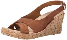 crocs Women's A Leigh Shimmer LTHR Wedge Sandal, Brown Shimmer, 7 B(M) US. Genuine leather upper with updated strap design. Exceptionally comfortable croslite material footbed. 2.75 Inch cork wrapped mini wedge heel. Rubber outsole pods improve traction.
