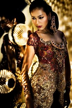 Indonesian women in modern kebaya by Anne Avantie.  Kebaya is the traditional dress from Indonesia.  This dress is usually worn during the wedding ceremony.
