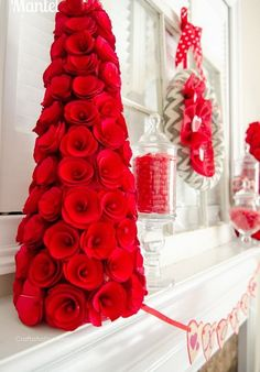 Rolled paper roses tree for mantel decoration. Rolled paper roses make a beautiful tree and add romance to your Valentine's Day!