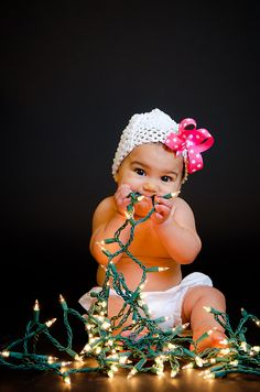 Baby girl with Christmas lights