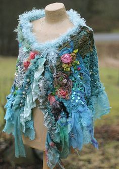 RESERVED---part payment  Bold shabby chic slightly asymmetric cape/shrug is made of crocheted lacy piece, adorned with textile collage from vintage textiles- laces, dyed silks, vintage ornate trims, accentuated with sequins, pearls, hand stitched details, cameo image in frame ( features one of my paintings of baroque lady) The collarline is trimmed with soft fur trim. Fastens at front with vintage brooch. The bottom edge is trimmed with hand dyed turquoise lace trim. One of a kind piece....