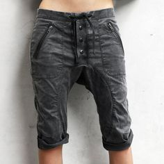 Women's Continuum Shorts - Charcoal. The moderate drop crotch with a button fly and drawstring is supremely comfortable, and leather ribbed front and back zip pockets keep your valuables in place when you are hanging from the rafters. We even added a brass key loop, because we're all about the details.  Produced in small batches and hand painted in a Charcoal color way to give it a unique lived-in look.