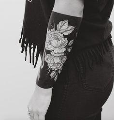 Heavy blackwork floral cuff tattoo by Tritoan Ly