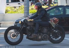 Vroom vroom!Wearing a pair of thick mustard-yellow coloured gloves, the father of four wa...